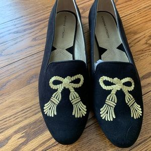 Black loafers with gold embroidery
